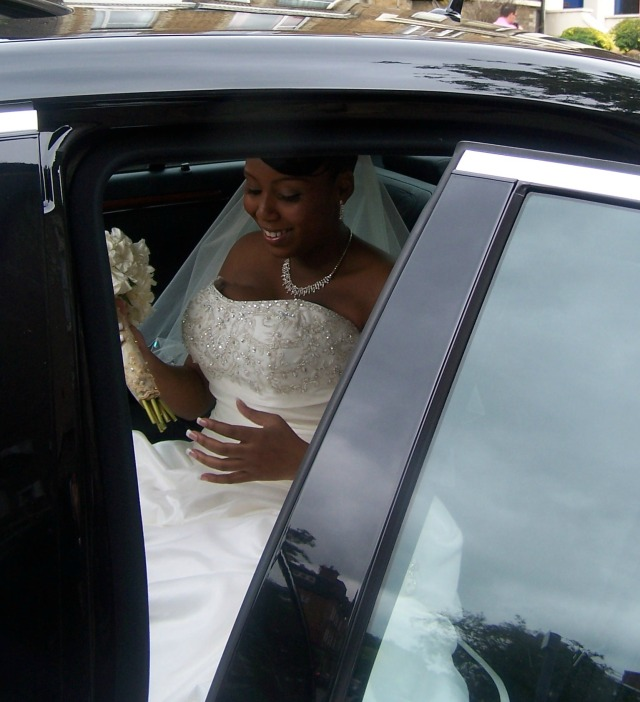 leah happy in car and bouquet