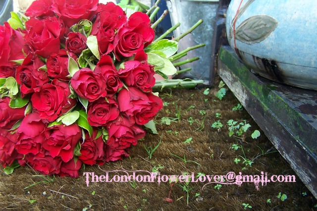 red rose bouquet on grass mat
