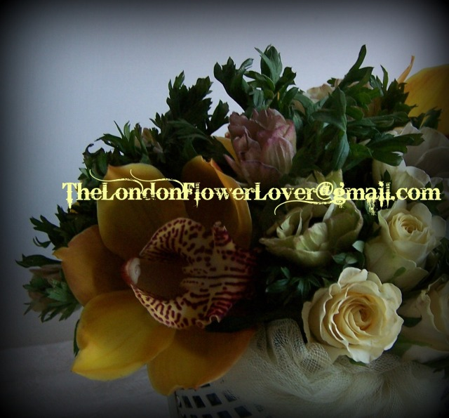the london flower lover yellow orchids and roses low table centre