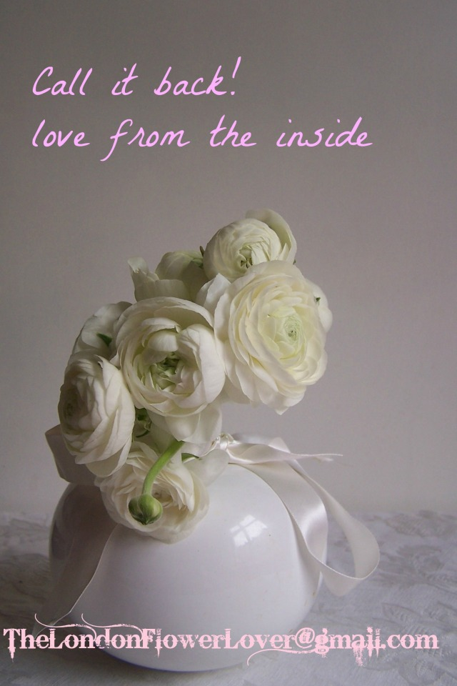 white rannuculus and white vase