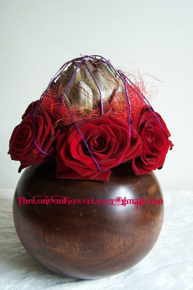 globe artichoke and red roses The London Flower Lover