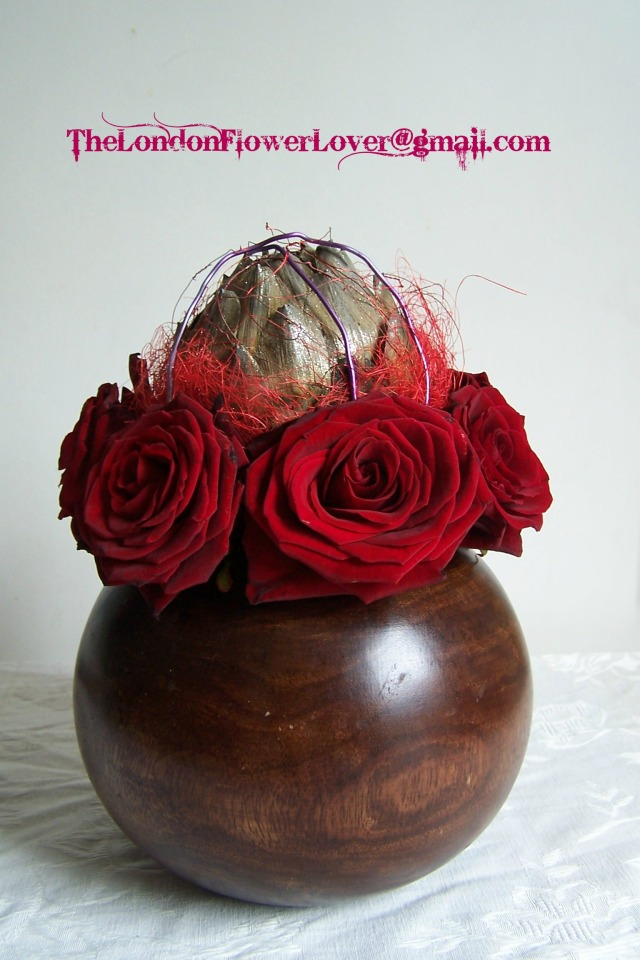 red roses, artichoke The London Flower Lover