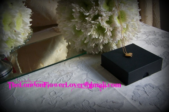 The London Flower Lover love heart necklace and flower spheres