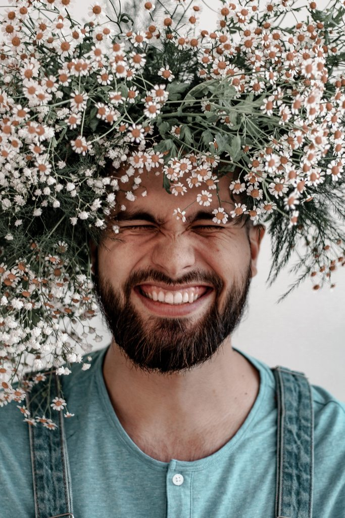 smiling man in the flowers